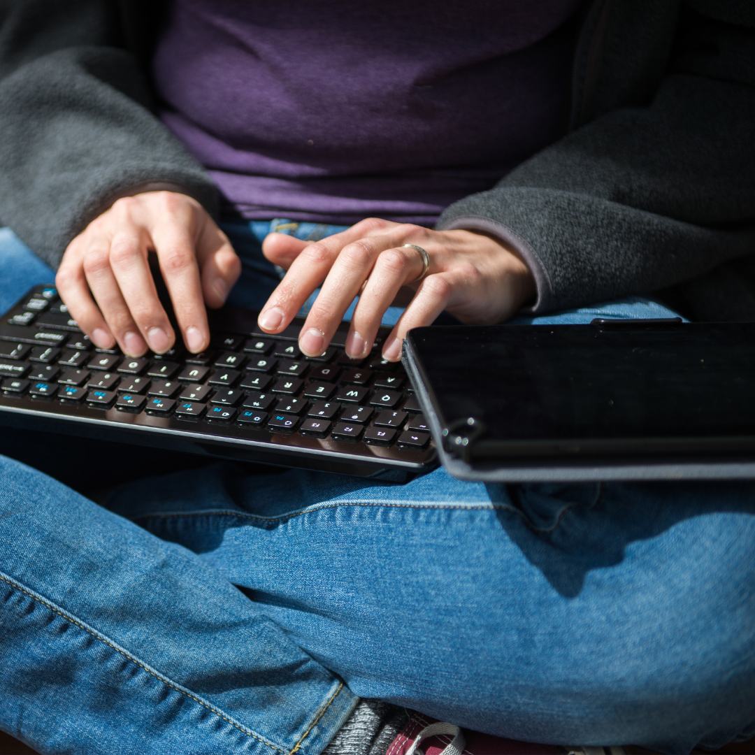 Student typing on keyboard